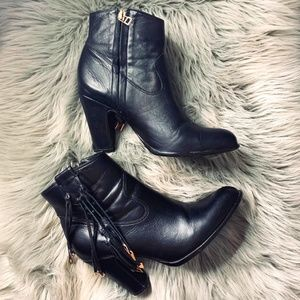 Black ankle boots with fringe